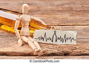 Human wooden figurine, alcohol beverage.
