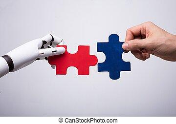 humano, rompecabezas, rompecabezas, robot, tenencia de la mano
