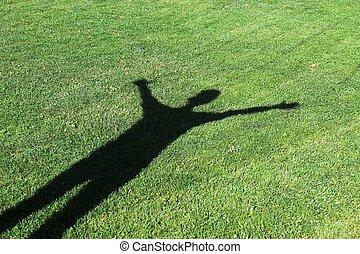humano, sombra, en, pasto o césped