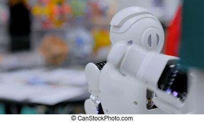 Humanoid robot dancing at robotic show - Humanoid futuristic...