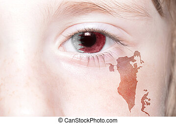 human's face with national flag and map of bahrain.