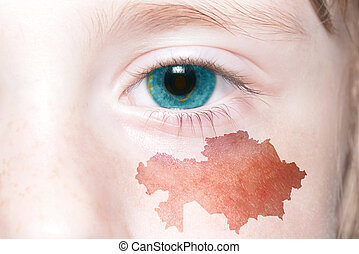human's face with national flag and map of kazakhstan.