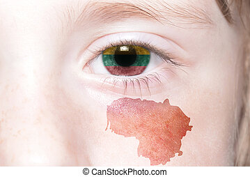 human's face with national flag and map of lithuania.