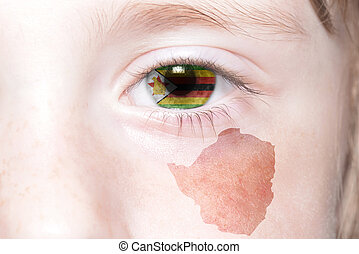 human's face with national flag and map of zimbabwe.