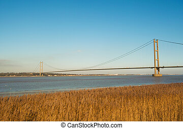 A view of the humber bridge from the south bank of the river humber