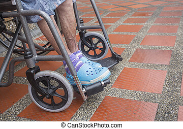 humble old woman in a wheelchair