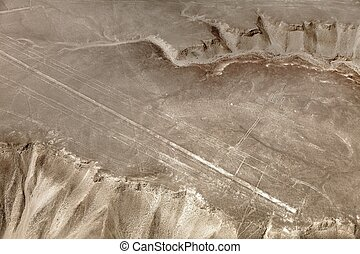 Hummingbird geoglyph sepia colored, Nazca or Nasca mysterious lines and geoglyphs aerial view, landmark in Peru