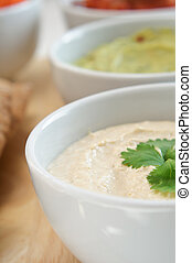 Hummus and Dips Close Up - Close up of a bowl of hummus with...