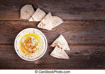 Hummus and pita bread - A bowl of fresh hummus, drizzled ...