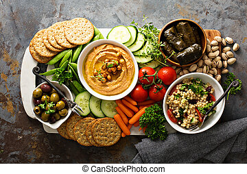 Hummus and vegetables platter with grain salad - Hummus and ...