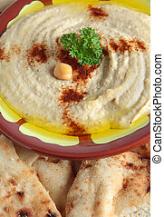 Hummus bi tahini vertical - The traditional Middle Eastern...