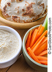 Hummus Dip and Pitta Breads with Crudites - Close up of...