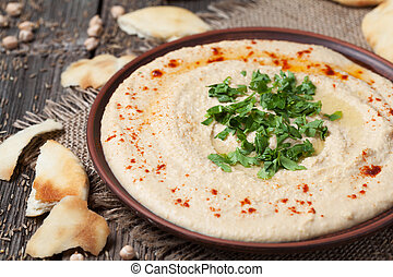 Hummus, healthy lebanese traditional creamy food with chick-...