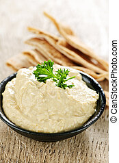 Hummus with pita bread - Bowl of fresh hummus dip with pita ...
