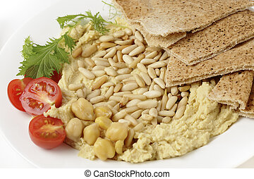 Hummus with roasted pine nuts - Hummus and lightly roasted...