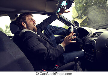man driving a car