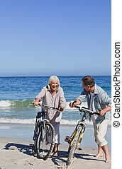 hun, paar, fietsen, strand, middelbare leeftijd