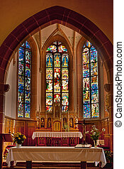 Altar of the church of Hunawihr wine village in the middle of vineyards of Alsace, France