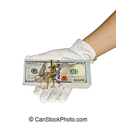 Hundred dollar banknotes in a hand with gift pack