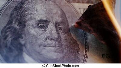 Hundred-dollar bill is on fire