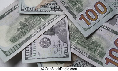 Hundred dollar bills are moving in a circle, close-up.