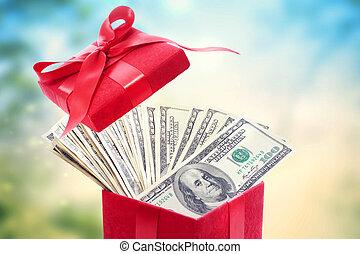 Hundred dollar bills in a big red present box
