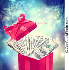 Hundred dollar bills in the red present box at magic night