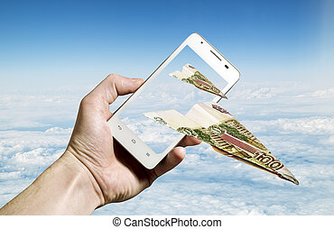 Hundred-ruble notes folded in the form of the aircraft flying from the screen of the smartphone