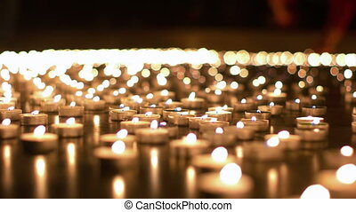 Hundreds of Candles Burning During Church Event