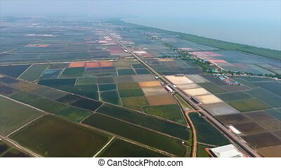 Hundreds of separated ponds close to the sea - A birds eye...