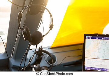 Hung headset in a cockpit of a plane