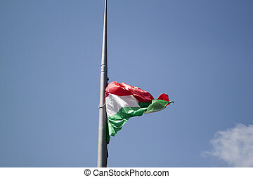 Hungarian flag on a blue sky with clouds background