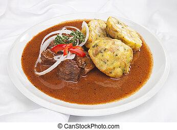 Hungarian goulash w dumplings and vegetable garnish