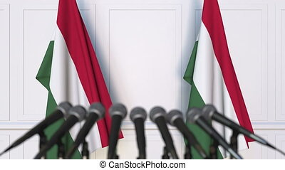 Hungarian official press conference with flags of Hungary....