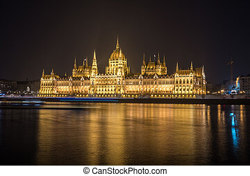 Hungarian Parliament Building on the bank of the Danube in Budapest at night