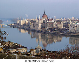 "A panoramic view of famous Hungarian Parliament building the ""Pest"" side of Budapest from Castle Hill in Buda."