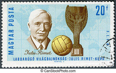 HUNGARY - CIRCA 1966: A stamp printed in Hungary shows Jules Rimet (1873-1956) who was the 3rd President of FIFA, Cup and Soccer Ball, circa 1966
