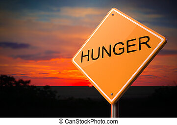 Hunger on Warning Road Sign on Sunset Sky Background.