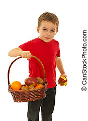 Hungry boy with fruits in basket