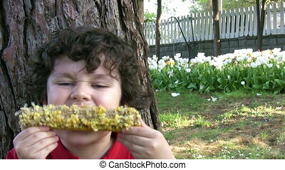 Hungry Child Eating Corn