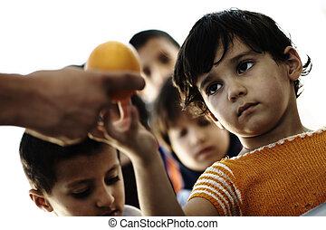 Hungry children in refugee camp, di