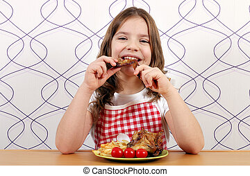 hungry girl eating chicken wings