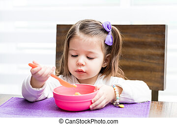 Hungry Girl Eating Food From Bowl