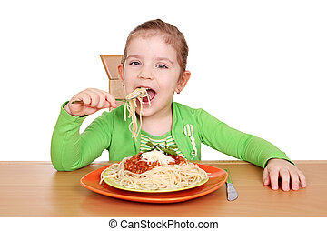 hungry little girl eating spaghetti