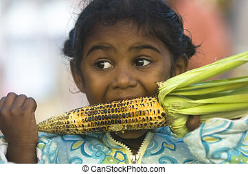 hungry - small Tamil girl eating corn on the cob