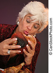 Hungry woman eating meat