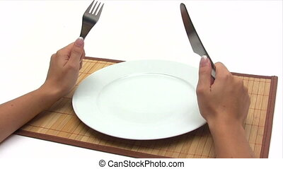 Hungry - Woman with fork and knife in her hands waiting for...
