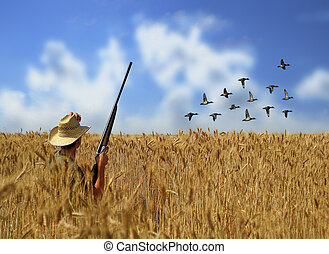 Hunter - A man hunting ducks in a grain field