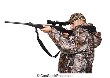 Hunter aiming a rifle while wearing camouflage clothing,...