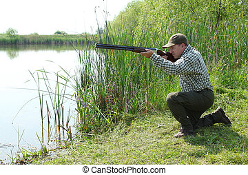 hunter aiming and ready for shot